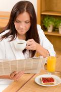Stock Photo of breakfast at home happy woman read newspapers