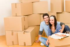 moving new home young couple eat pizza - stock photo
