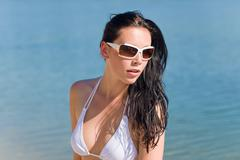 Young sexy bikini model with white sunglasses Stock Photos