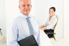 Stock Photo of professional senior businessman hold briefcase