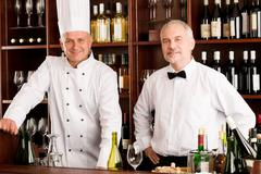 chef cook and waiter restaurant wine bar - stock photo
