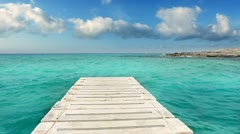 Beach wooden pier turquoise sea Formentera Balearic islands Mediterranean Stock Footage