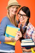 two woman friends young students hold books - stock photo
