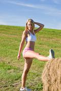 stretching sport fit woman summer blue sky - stock photo