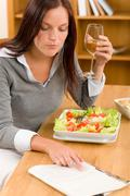 Stock Photo of healthy lunch at home woman read magazine