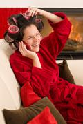 home beauty woman with hair curlers calling - stock photo