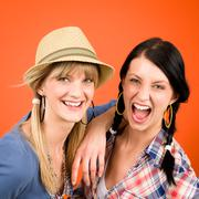 Two woman friends young crazy smile Stock Photos
