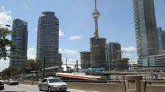 Traffic At Queens Quay Toronto With The CN Tower Stock Footage