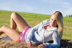 sportive young woman relax on hay bales - stock photo