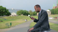 Businessman with smartphone in the city Stock Footage