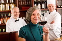 Stock Photo of restaurant manager taste glass red wine bar