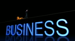 Businessman walks the tight rope of fire Stock Footage