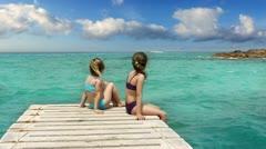 Little sisters girls looking idyllic landscape in formentera Stock Footage