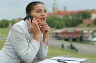 Businesswoman with documents and cellphone in the city Stock Footage