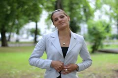 Portrait of smiling businesswoman in the city park Stock Footage