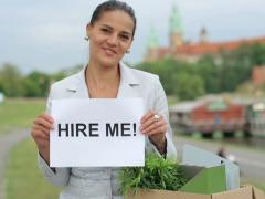 "Happy jobless businesswoman holding paper sheet with ""HIRE ME"" sign Stock Footage"