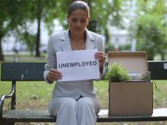 """Just fired sad businesswoman holding paper sheet with """"UNEMPLOYED"""" sign Stock Footage"""