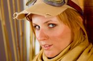 Young woman sunburned face with pilot goggles Stock Photos