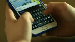 Hands using smartphone Stock Footage