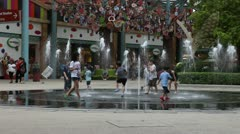 children are playing near a fountain - stock footage