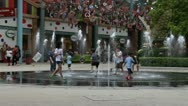 Children are playing near a fountain Stock Footage