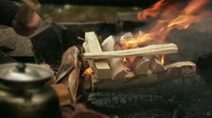 A man making a camp fire Stock Footage
