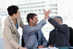 Victorious business team working together - stock photo