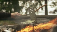 Cooking over a camp fire Stock Footage