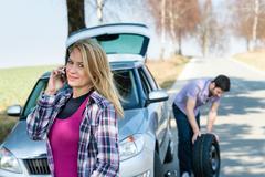 car wheel defect man change puncture tire - stock photo