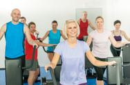Stock Photo of fitness young group on elliptical cross trainer