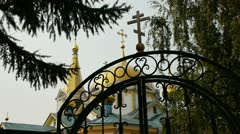 The domes of the Orthodox Church and the gates. - stock footage