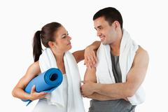 Healthy couple going to practice yoga - stock photo