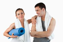 Cute couple going to practice yoga - stock photo