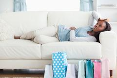 Woman taking a rest after shopping - stock photo
