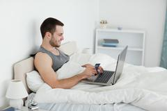Man purchasing online - stock photo