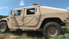 Hummvee driving 3PR Stock Footage