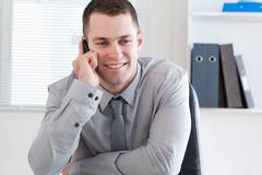 Stock Photo of Businessman using his cellphone