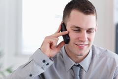 Businessman listening closely yo caller - stock photo