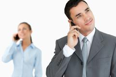 Stock Photo of Business partners on the cellphone