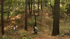A man and a woman picking mushrooms in the forest Stock Footage