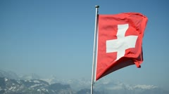 Swiss flag with mountain panorama from Rothorn Stock Footage