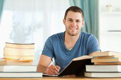 Stock Photo of Smiling student preparing for exam