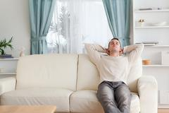 Man resting on a couch - stock photo
