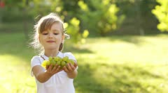 Girl treats the viewer grapes Stock Footage