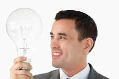 Close up of businessman with huge light bulb Stock Photos