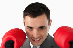 Close up of businessman with boxing gloves on - stock photo