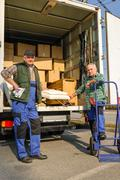 two mover load van with furniture boxes - stock photo