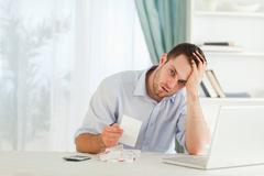Businessman worried about an invoice Stock Photos