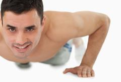 Young male doing push ups - stock photo