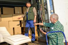 Two mover load van with furniture boxes Stock Photos